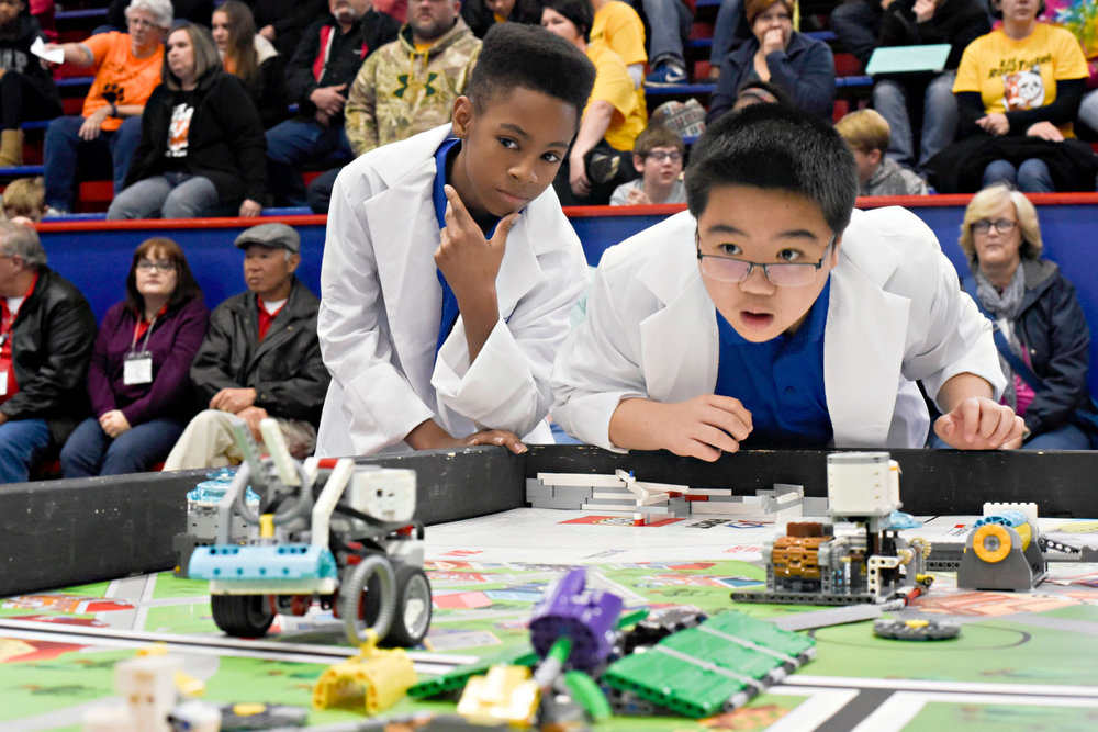 Sheddrick Lewis, left, and Jonathan Eng of the Polar Bear Bots team watch as their EV3 Mindstorm Robot completes challenges during the FIRST Lego League Red Carpet Qualifier at Warren Central High Saturday.  (Courtland Wells/The Vicksburg Post)