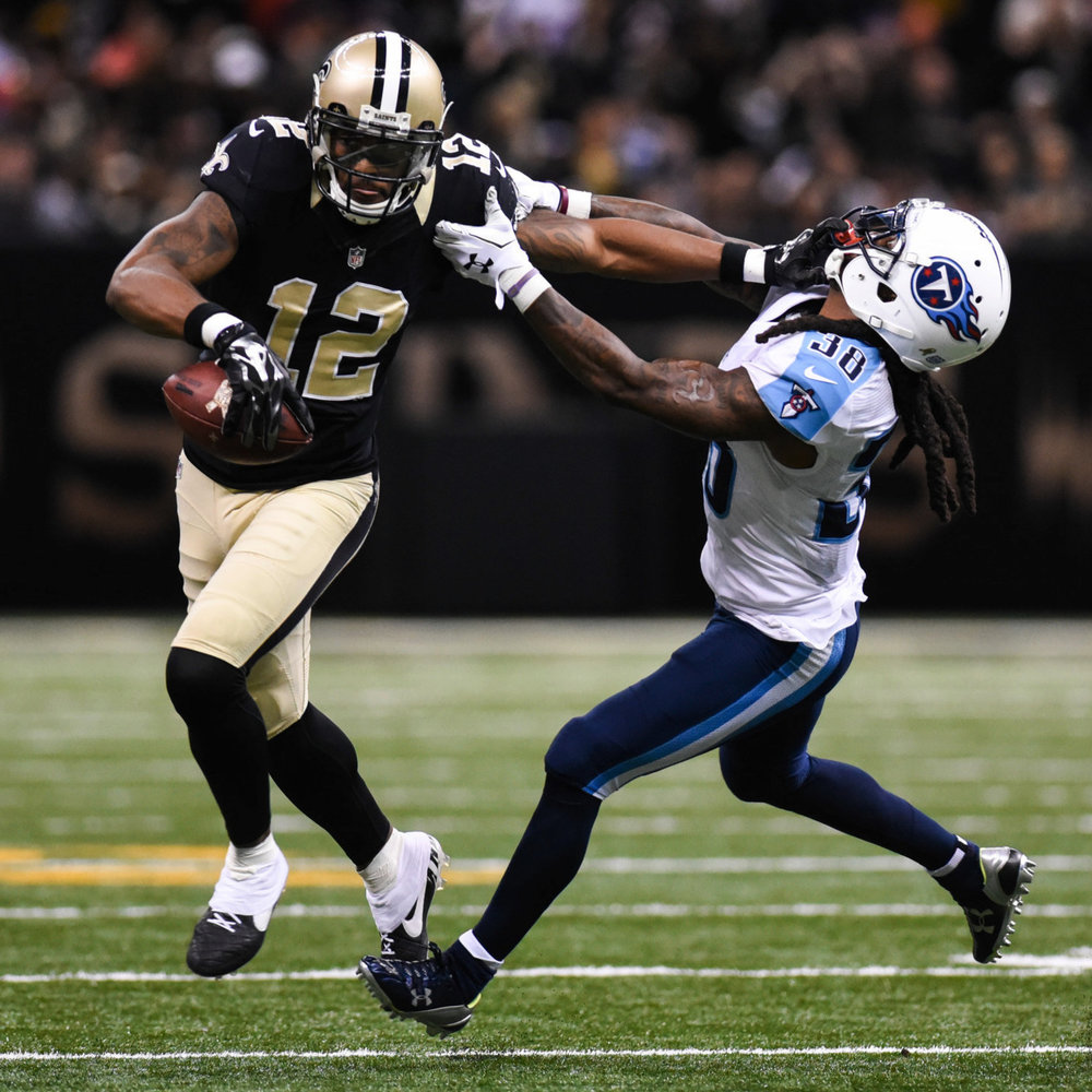 Marques Colton stiff-arms B.W. Webb while running after a reception on Nov 8th at the Mercedes-Benz Superdome in New Orleans. The Saints fell to the Titans 34-28 in overtime.
