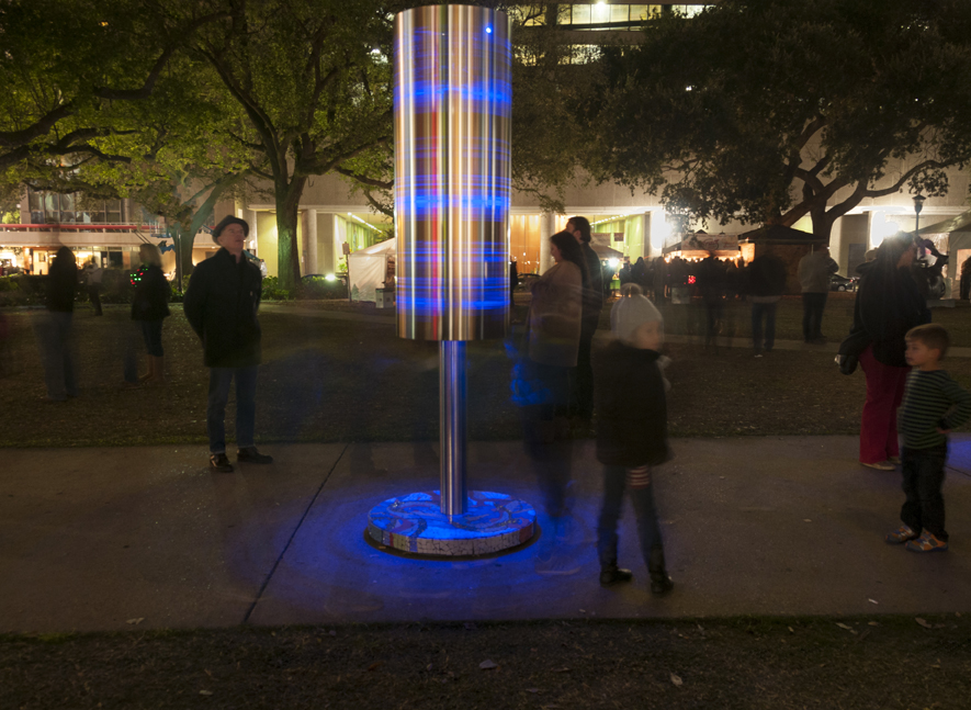 """Turning, (Prayer wheels for the Mississippi River)"", 2017, Stainless steel rotating cylinders (water-jet cut and engraved), with mosaic bases, View at Luna fete, collection of the City of New Orleans,  Dimensions: 3 individual sculptures at 8' ht x 24"" diameter cylinders, 3' diameter bases, Maps on cylinders courtesy of Kate Orff/Scape from Petrochemical America-Misrach/Orff, Aperture, 2012, Images of ""Turning"" courtesy of Michel Varisco, ©Michel Varisco"