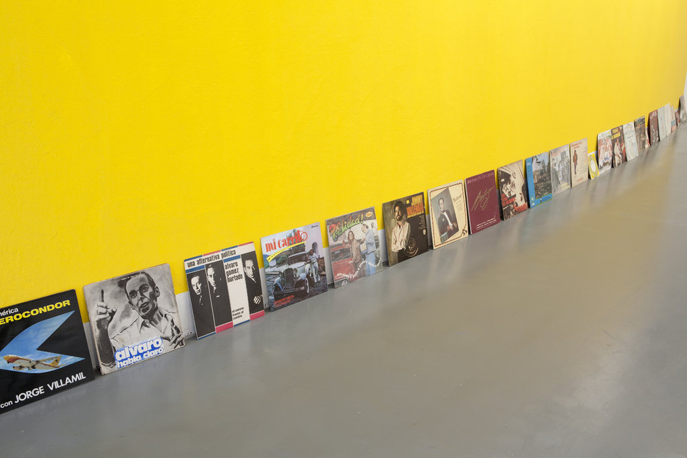 Wilson Diaz, Amarillismo 2014, Installation, yellow paint and 14 Vinyl, Various dimensions Image courtesy of the Artist and Instituto de Vision. Credits: Pablo Adarme