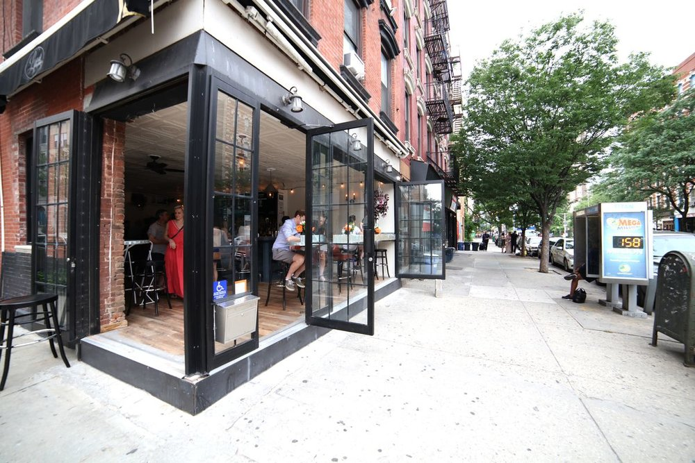 From the outside, Loverboy's gigantic doors swing open to allow for a gently NYC breeze, image taken by eaterny.com.