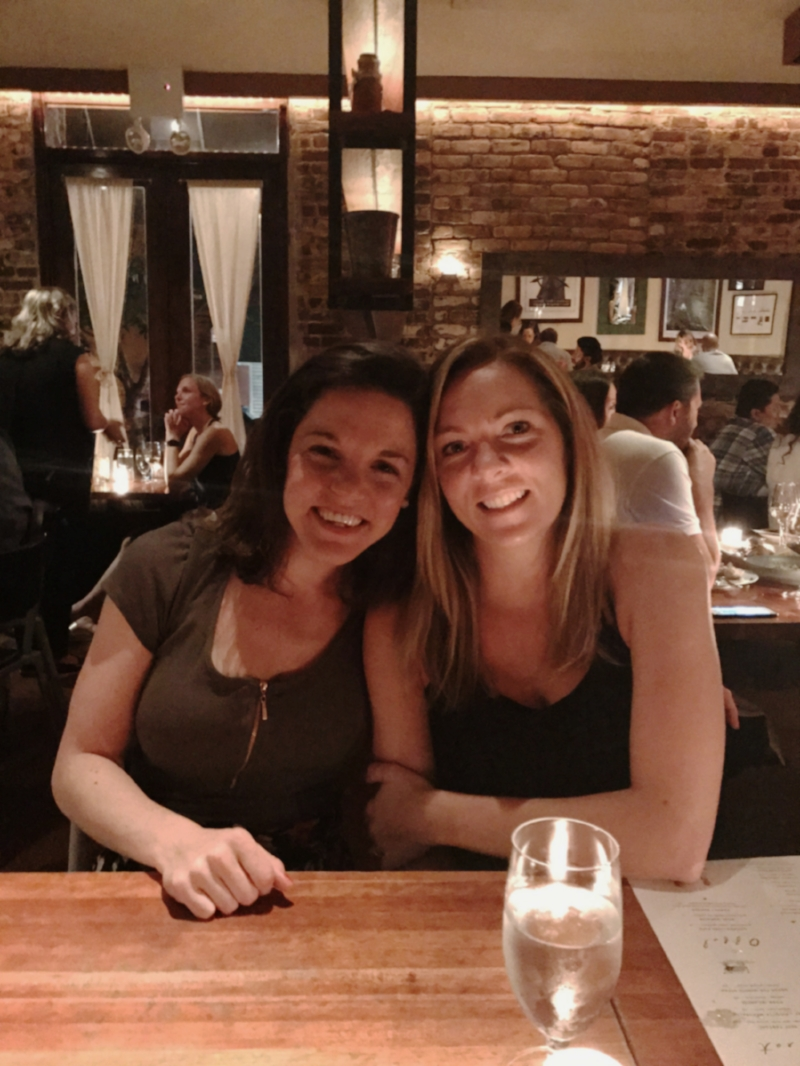 Erica and her best friend getting cozy at the table at Hearth.