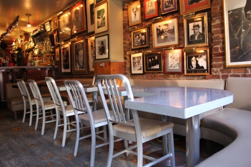 The tables at Rue B can seat at least two people at a table, but most sit on the bench only so as to get a great view of the band. Image courtesy of newyorkevoce.com.