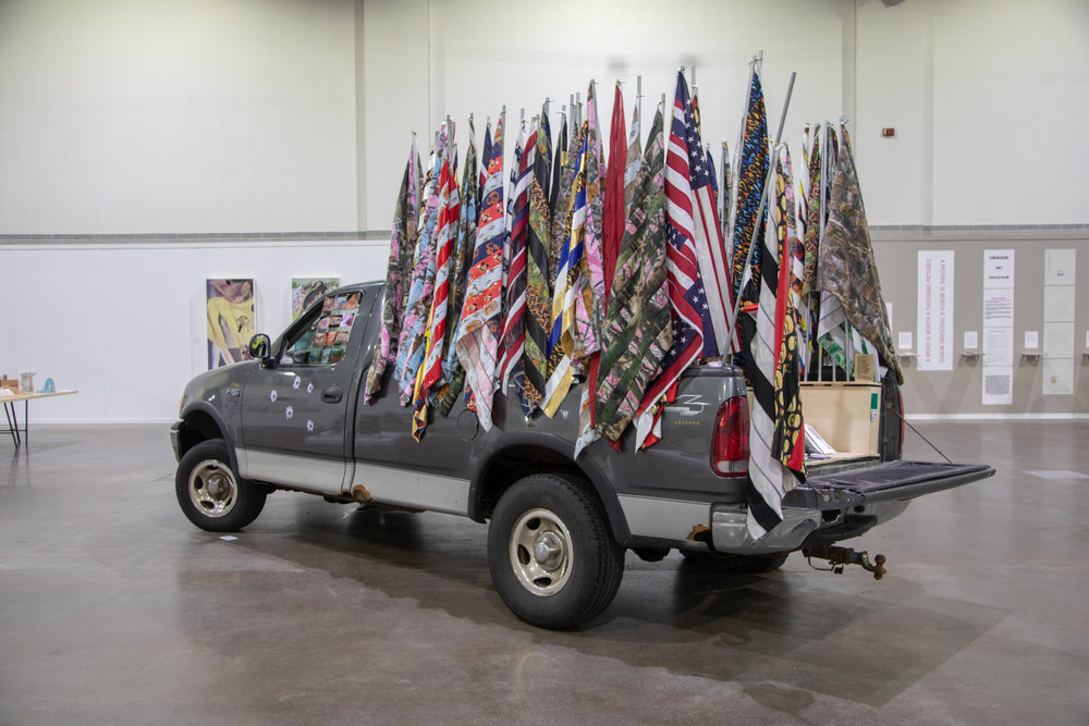 Americans Only Pop-Up Gallery, 2018  Ford F150 pick-up truck, 50 hand-made flags, UV prints on plexi and vinyl, rivets, laser cut keychains, stoneware, zines, patches, steel, wood, hardware, mixed media