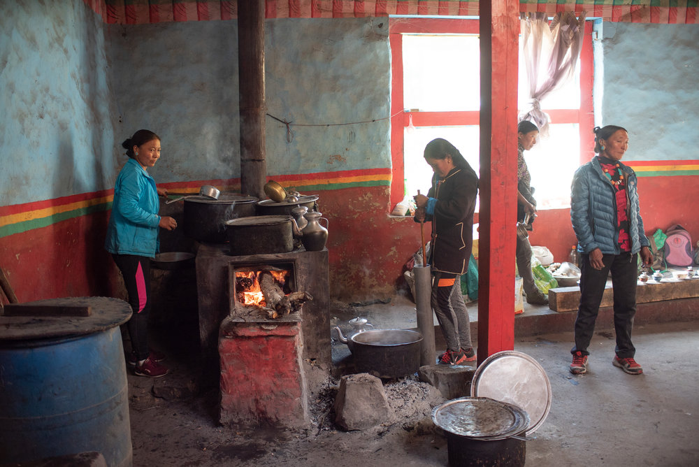Preparing breakfast and the butter tea.