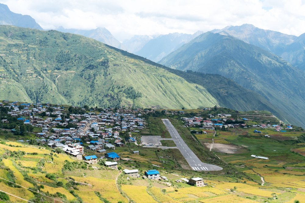The town of Simikot and its airport perched on a flat area on a mountain. Every time a cloud passes no planes can land or takeoff.