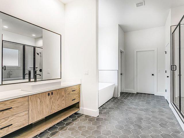 Modern oak cabinets + hexagon tiles + black accents = 🖤  #bridgewayhomesokc  #masterbath #newhome #newconstruction #homebuilder #edmond #homedesign #hexagontiles