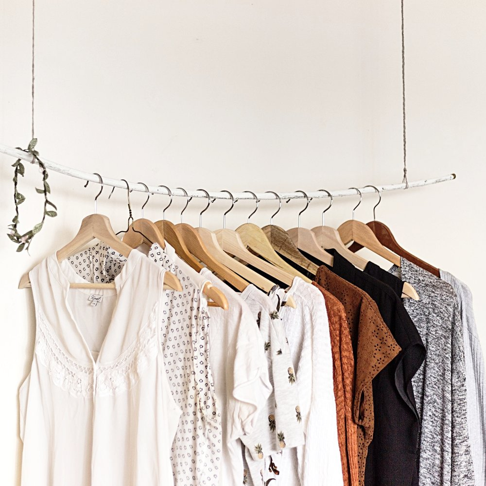 minimalist clothing on rack