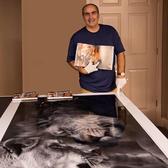 Emmanuel with his award-winning Lions in Love print.
