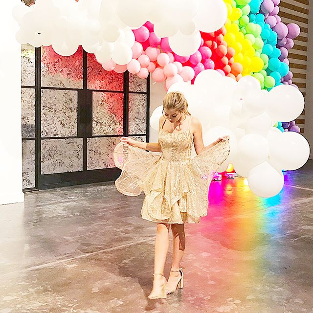 There is gold at the end of a rainbow 🌈  Another one of my favorite HOCO looks from @ch_couturehouse .This is actually a rental && Couture House has hundreds that you can rent or you can buy one to keep!  How cute is this rainbow set created by  @bigassballoons at the @therevaire event. Make sure to follow all three of these fun accounts by tapping this pic!  Happy Tuesday y'all!  XoXo Millie... . . . You can link directly to Couture House through my story . . . #hoco2k18 #hocodress #hocoproposal #gold #rainbow #balloons #blogger #htx #htxbloggerbabe #htxblogger #igblogger #igbloggers #igfashion