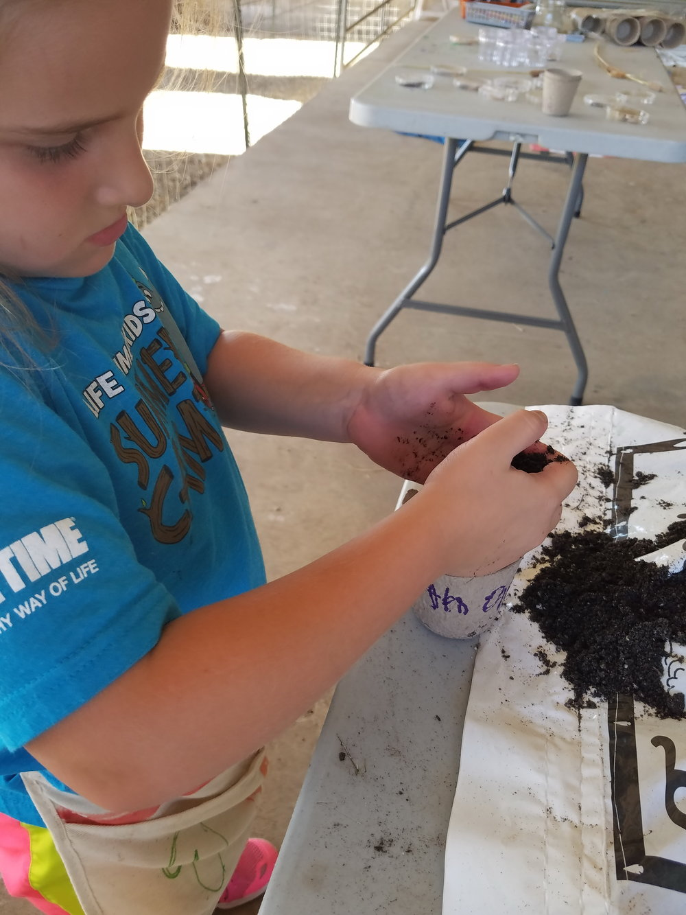 When the children were asked where soil comes from they first thought it was just dirt. After a lesson on decomposing plant matter and animal waste, they determined that it was much more than that. They planted seeds so that they can grow pollinator friendly plants at home.