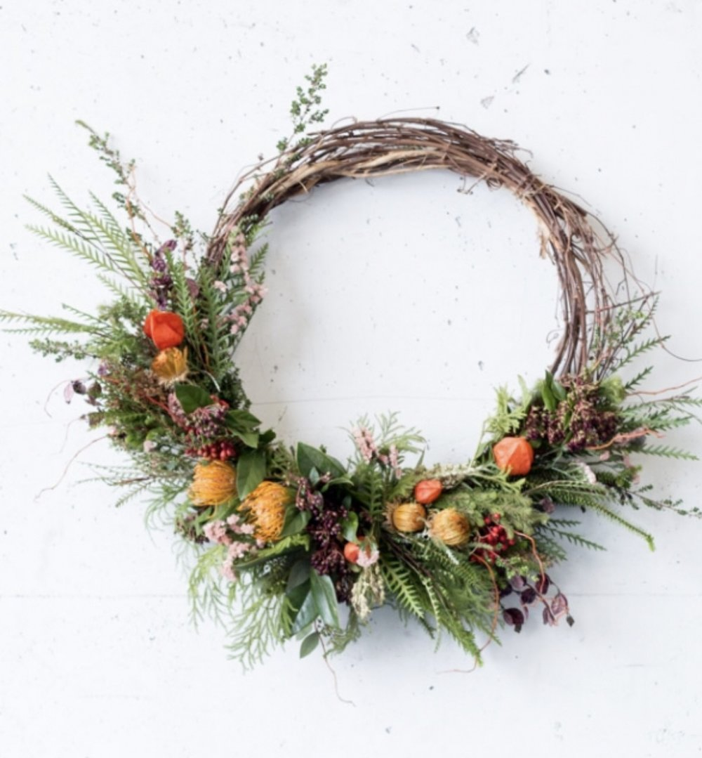 "Farmgirl Flowers - With their asymmetrical designs that incorporate ""bits and pieces"" of seasonal goodies, I've got a bit of a crush on Farmgirl Flowers' aesthetic.$120, Harvest Wreath"