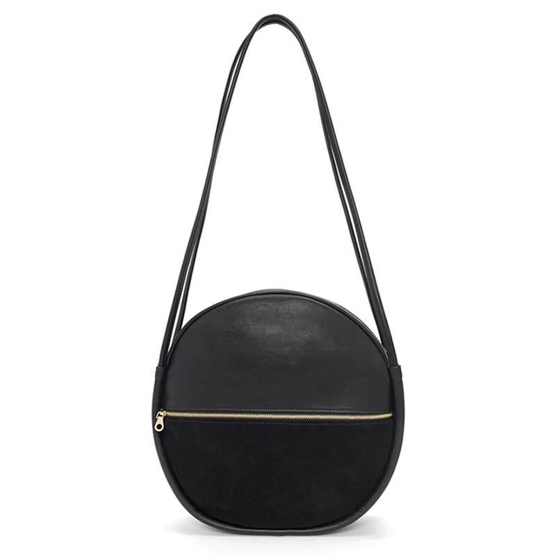 - Bando, Amigo Circle Bag in Onyx, $95Coming in five(!) different colors from poppy red to classic nude this suede and leatherette version adds a little hardware with its graphic addition of a zipper through the center. How's that for modern geometry?
