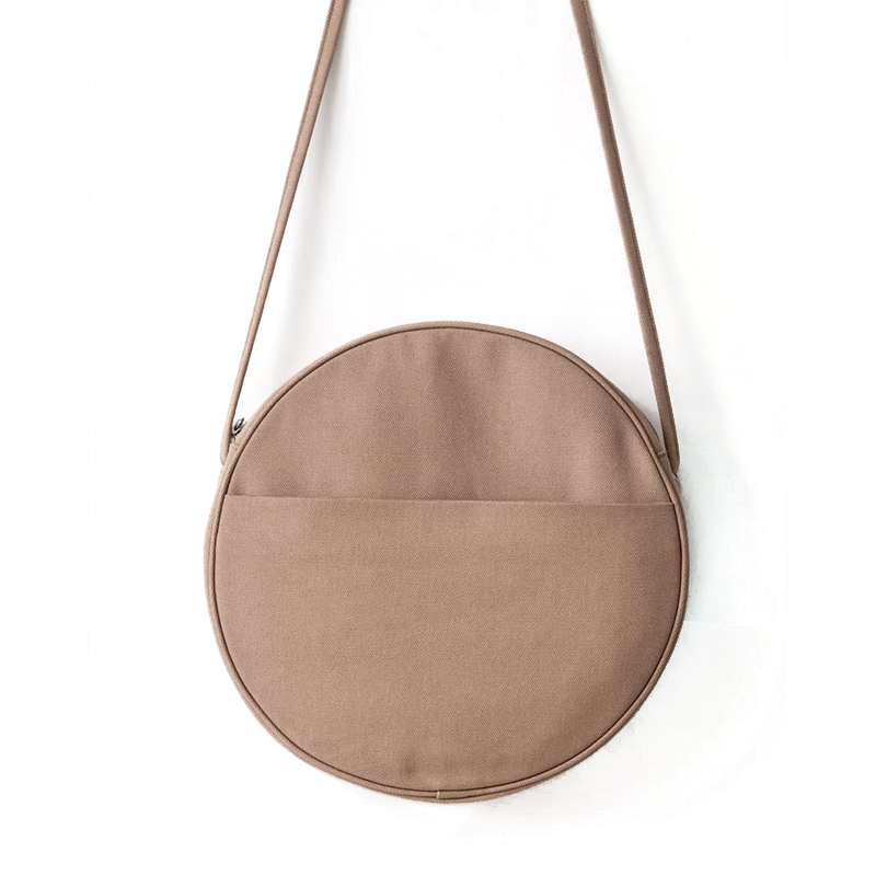 - Baggu, Small Canvas Circle Purse in Fawn, $45While their foldable, pocket-sized reusable bags are a genius way to never get caught empty-handed in the grocery checkout line, I'm also a huge fan of Baggu's simple, well-made bags in materials like canvas and leather. This bag is no exception, and with options starting at $45 is the most affordable one on our list. The utilitarian fabric and neutral color are a nice foil for the quirky silhouette.