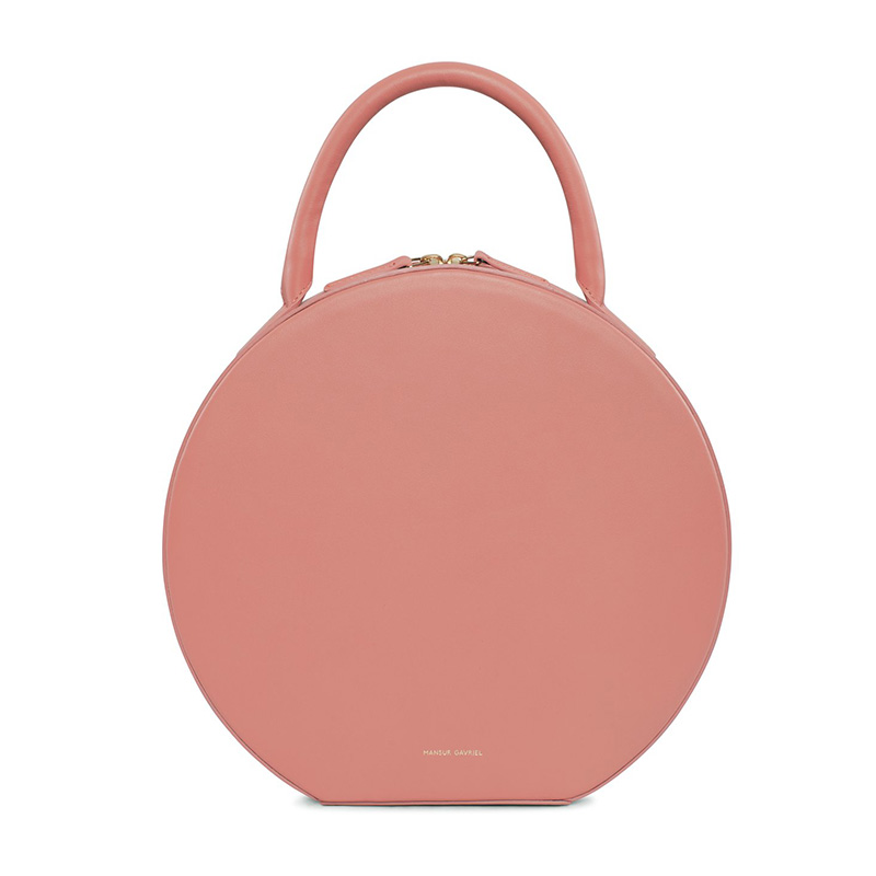 - Mansur Gavriel, Calf Circle Bag in blush, $1,095With a ladylike top handle, rosy hue and refined Italian leather this interpretation from cult brand Mansur Gavriel takes the shape from trend-driven piece to luxe classic.