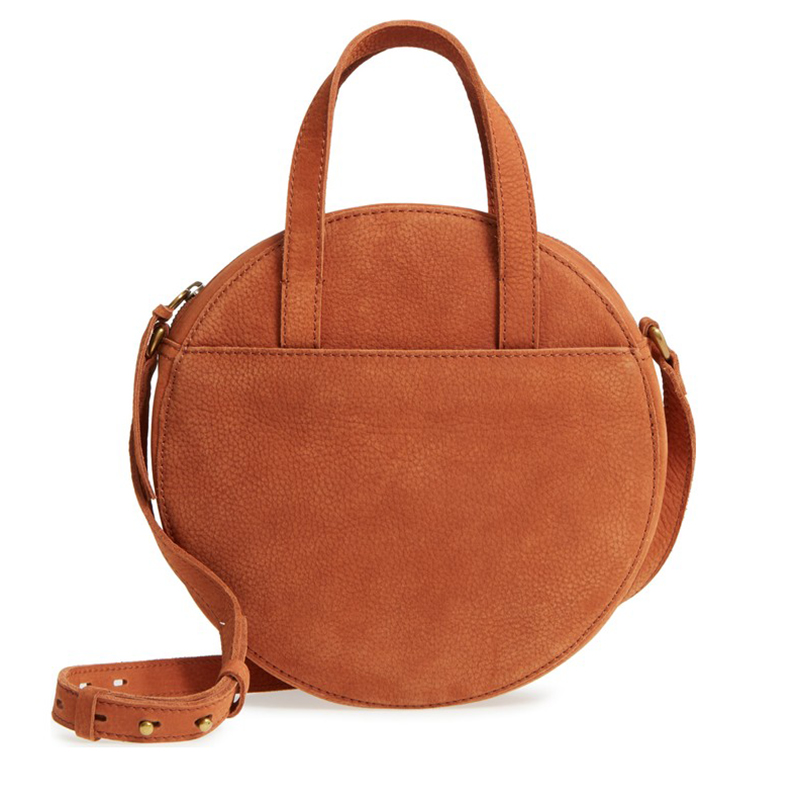 """- Madewell, Juno Circle Bag in Maple Syrup, $158If a brand loved by """"Capsule Wardrobe"""" enthusiasts for their endlessly versatile clothing comes out with such a bag, you can be confident that you could wear it with almost anything and still look self-possessed."""