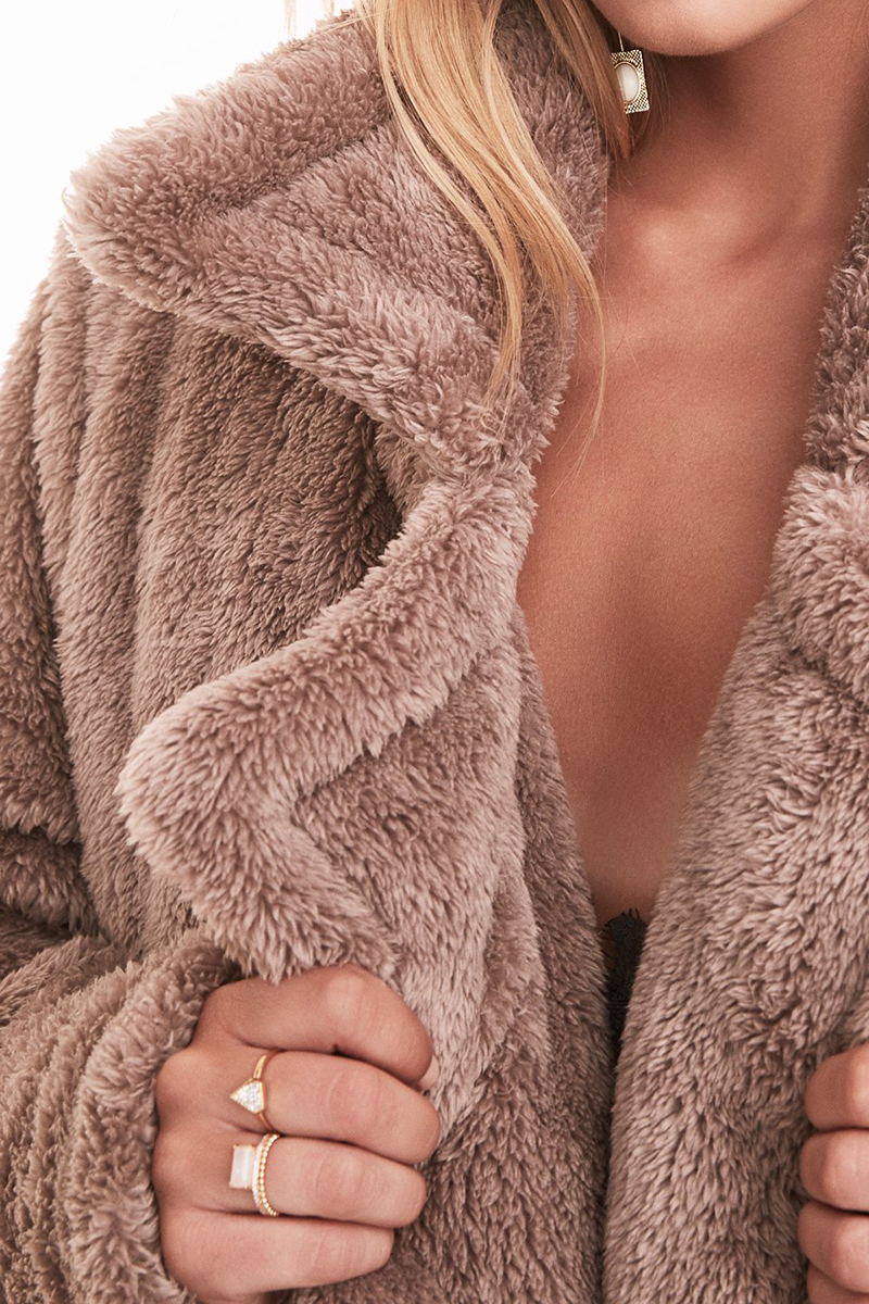 - Lovers and Friends, Teddy Fur Coat in Revival, $328A subtle shade of mink makes this version feel extra luxe.