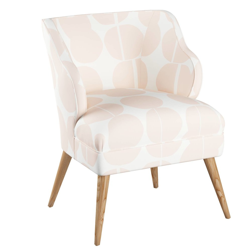 Modern Chair, Pink Dot $420 - A classic silhouette is updated with midcentury style turned legs and an oversized abstract dot print in a subtle shade of pink.