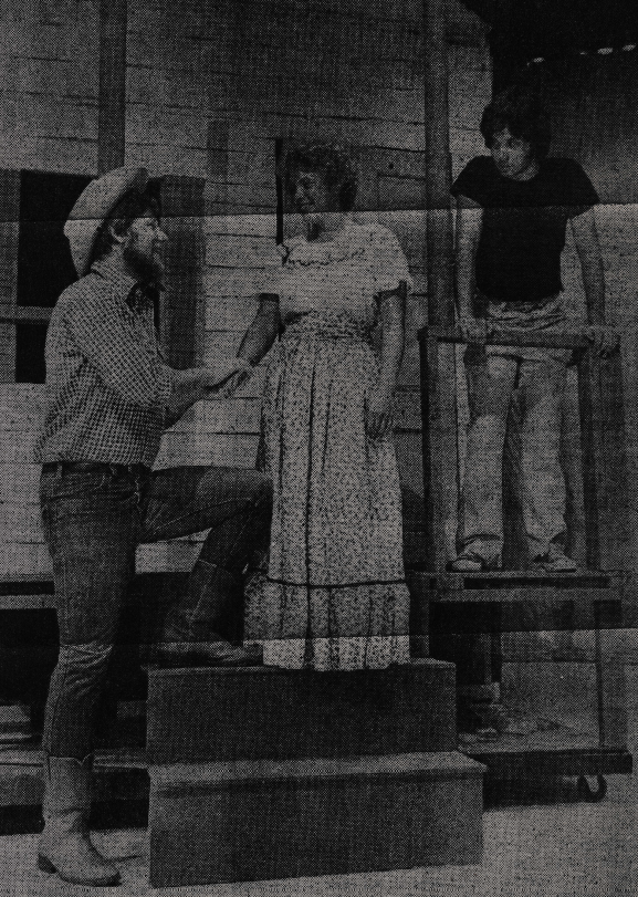"""Members of the cast rehearse a scene from """"Oklahoma"""" which will be presented Aug 15-16 at North Brunswick High School's Auditorium. Pictured from right to left are Kent Smith, Carol Hamilton, and Frank Russo."""
