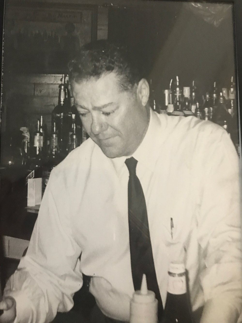 Grandpa Jim tending bar
