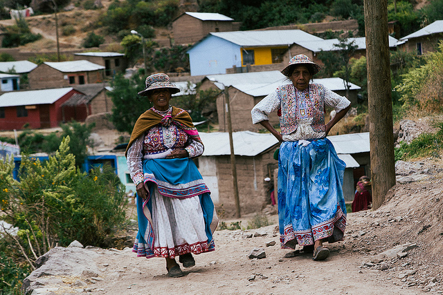 village ladies walking a path in peru