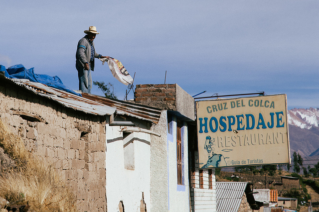 Village man on roof