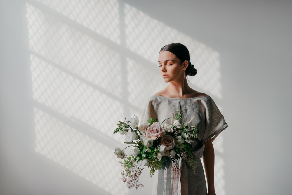 100% Linen Pinafore Top and Wrap Skirt by Nelly Gavrilov of Forma, Styled by Nicole Gavrilov of Mindful Makers Co, Photographed by Wendy Bobarikin, Modeled by Kennedy Marinelli, Florals by Anthousai of Tulsa, Oklahoma.