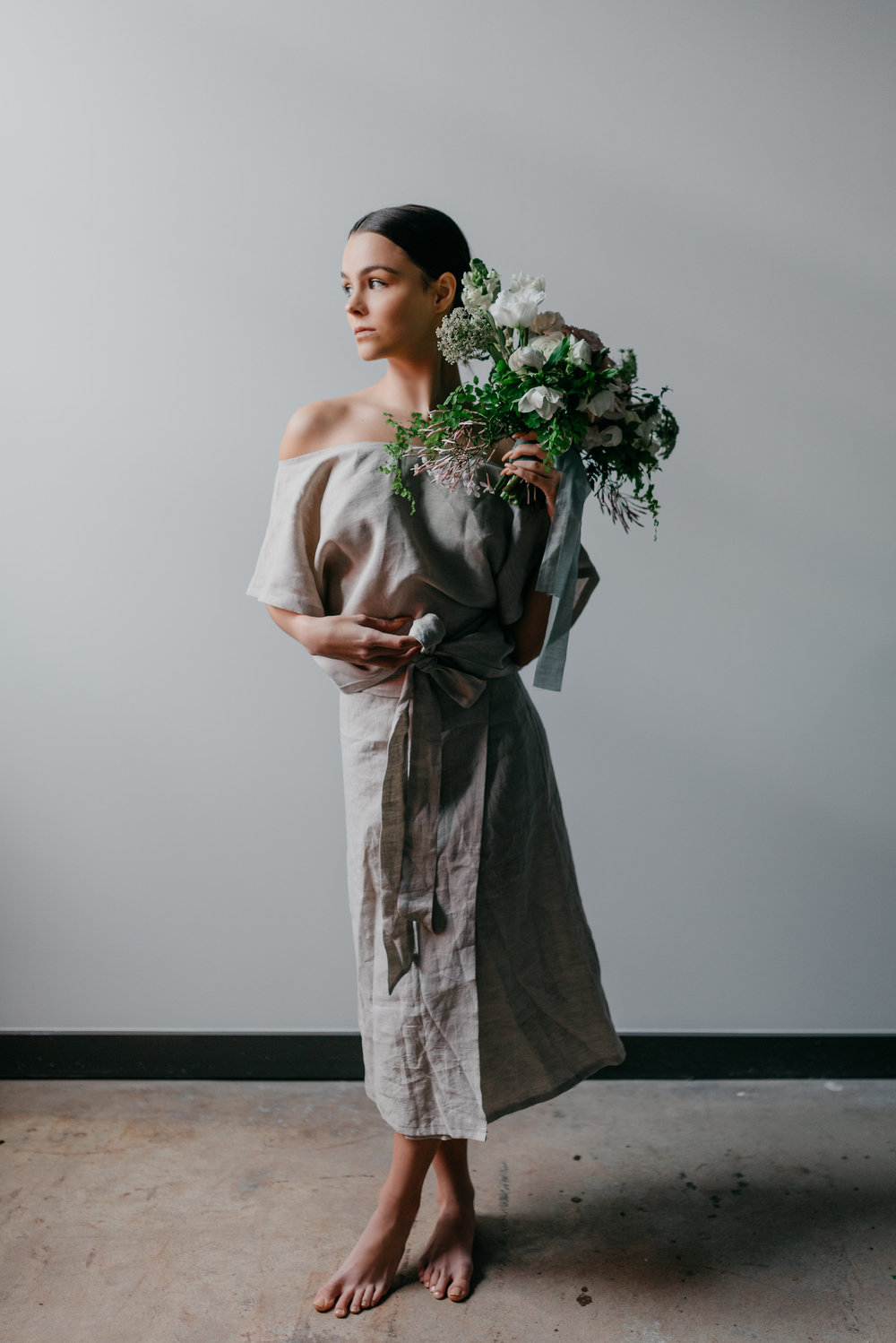 Standing in Linen and Light with Flowers