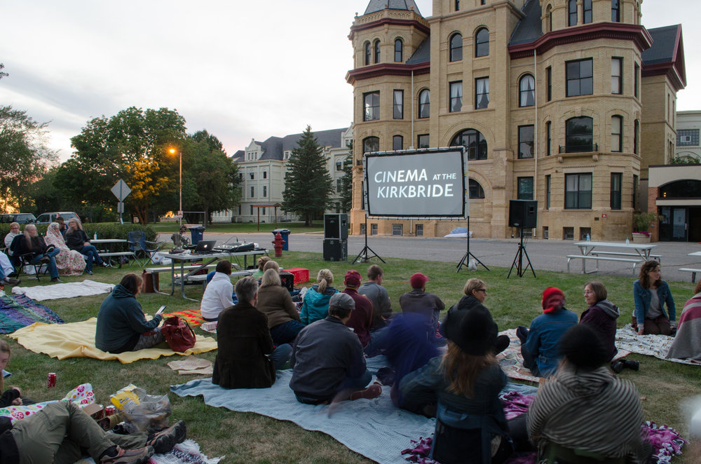 Fergus Falls residents gather for a movie on the grounds of the former state hospital.