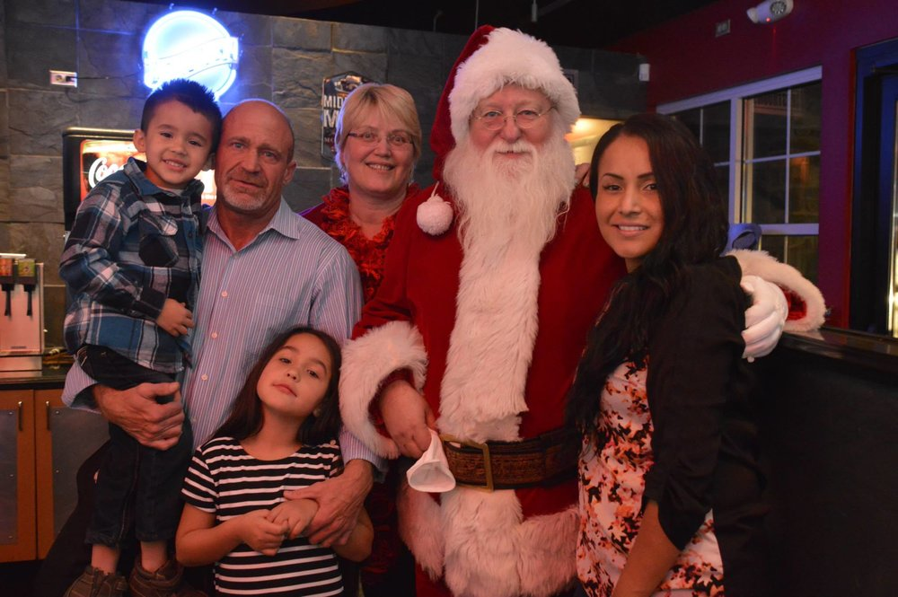 The Nixons accompanied by Santa Claus and Mrs. Clause. Illegal Burger in Arvada December, 2014.