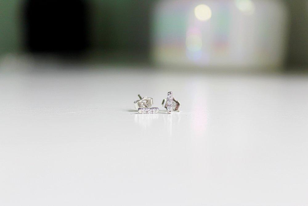 silver earrings with backdrop.JPG