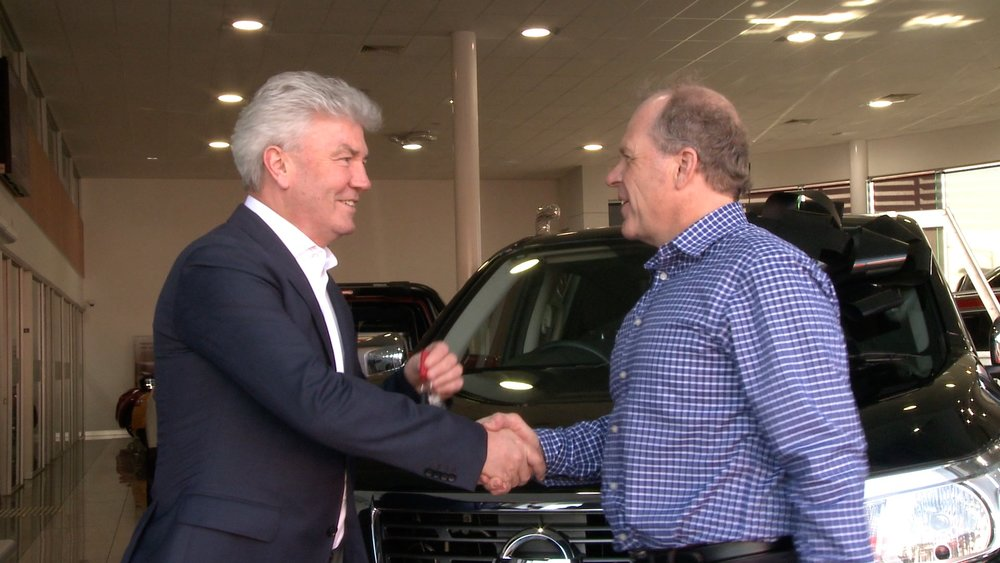 Conrad Taylor presenting Michael Smith with the keys for their new Nissan Navara.