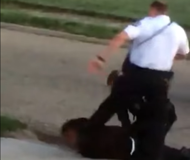 """Lorenzo Ramos Once again we run into police brutality and this time by someone who has gotten in trouble before. On Saturday, in Columbus Ohio officer Zachary Rosen was caught on tape kicking a handcuffed man DeMarco Anderson in the head even though he was laying on the ground, back facing the sky .In the video DeMarco Anderson can be heard saying """"Are you serious?"""" """"I got cuffs on sir, Are you serious."""""""