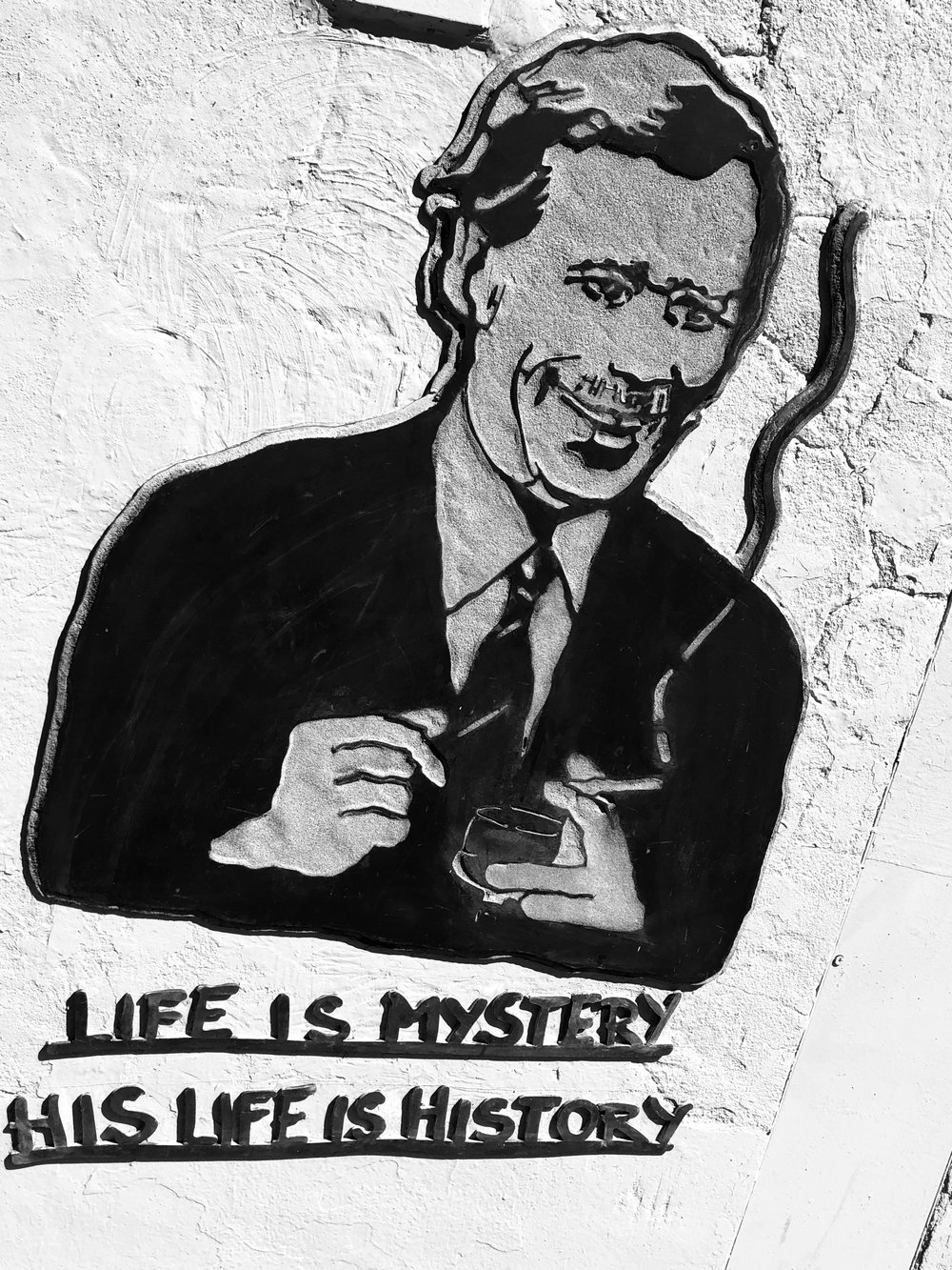 """Life is mystery, his life is history"": Vaclav Havel portrayed on a wall in Kampa Island. Prague, Czech Republic"