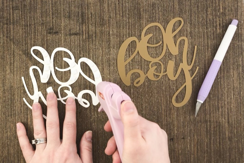 Hot glue is applied to the cake topper pieces cut with Cricut.jpg