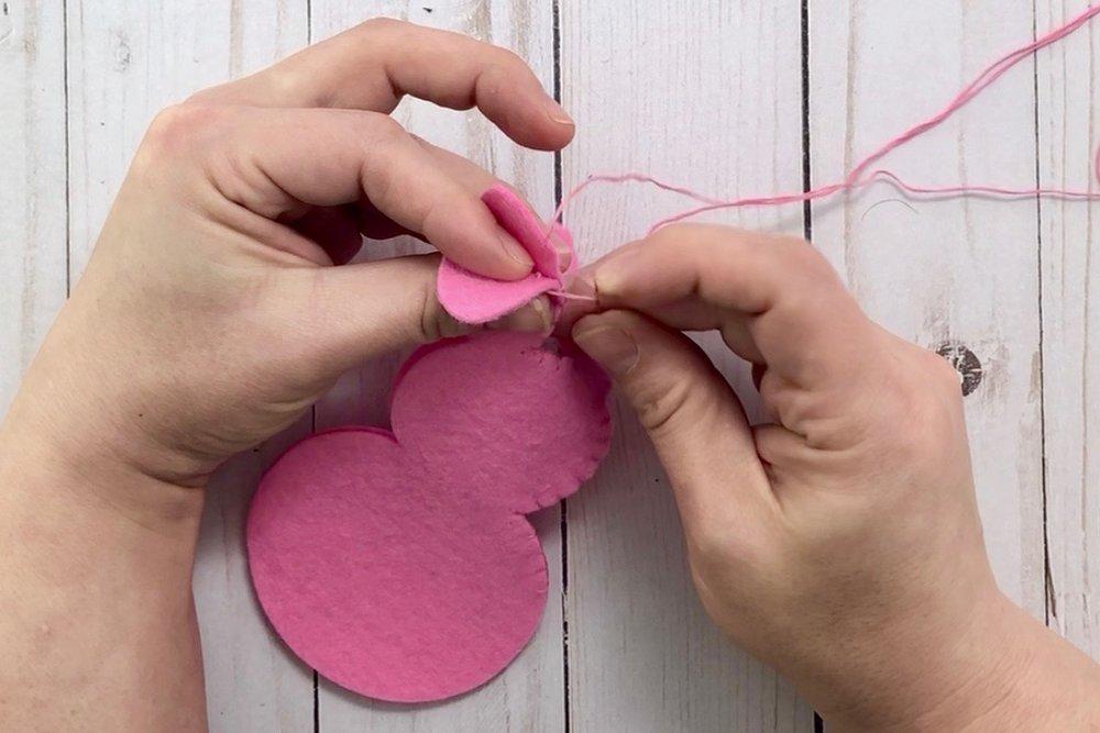 sewing Cricut felt bunny banner with blanket stitch