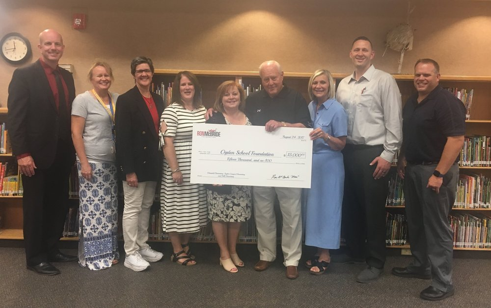 Check presentation to the Ogden School Foundation