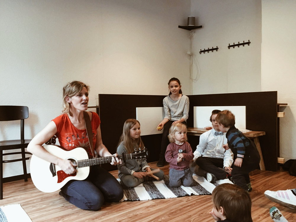 Samantha Stollenwerck singing for kids at Earth Day Concert in Nuremberg, Germany, at The Lunchbox.
