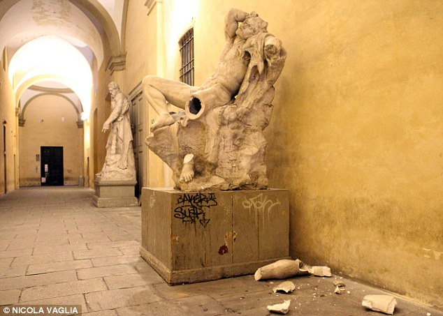 selfie stick bans statue destroyed milan selfie