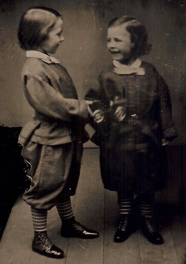 Earliest Known Images of People Smiling, Ambrotype of two children with a toy train