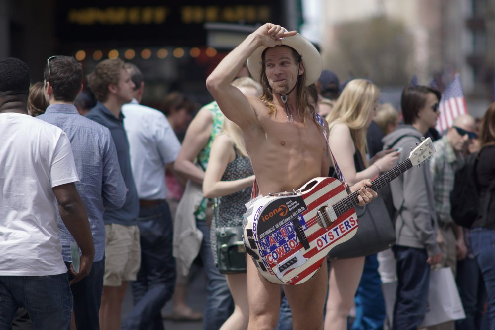 Street Photography with A Telephoto Lens, naked cowboy times square