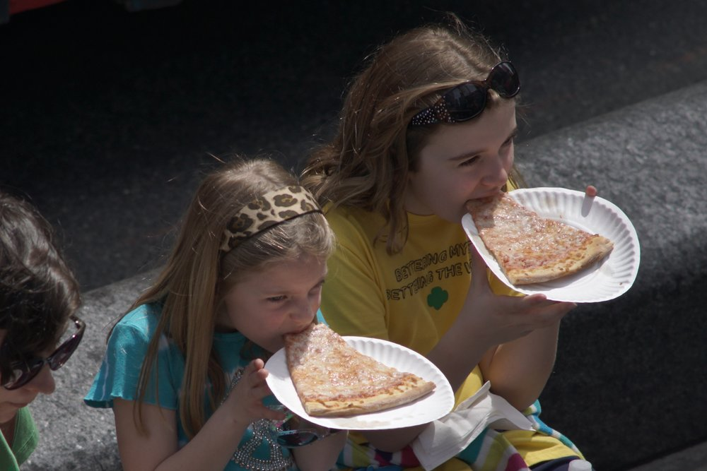 Street Photography with A Telephoto Lens, kids eating pizza