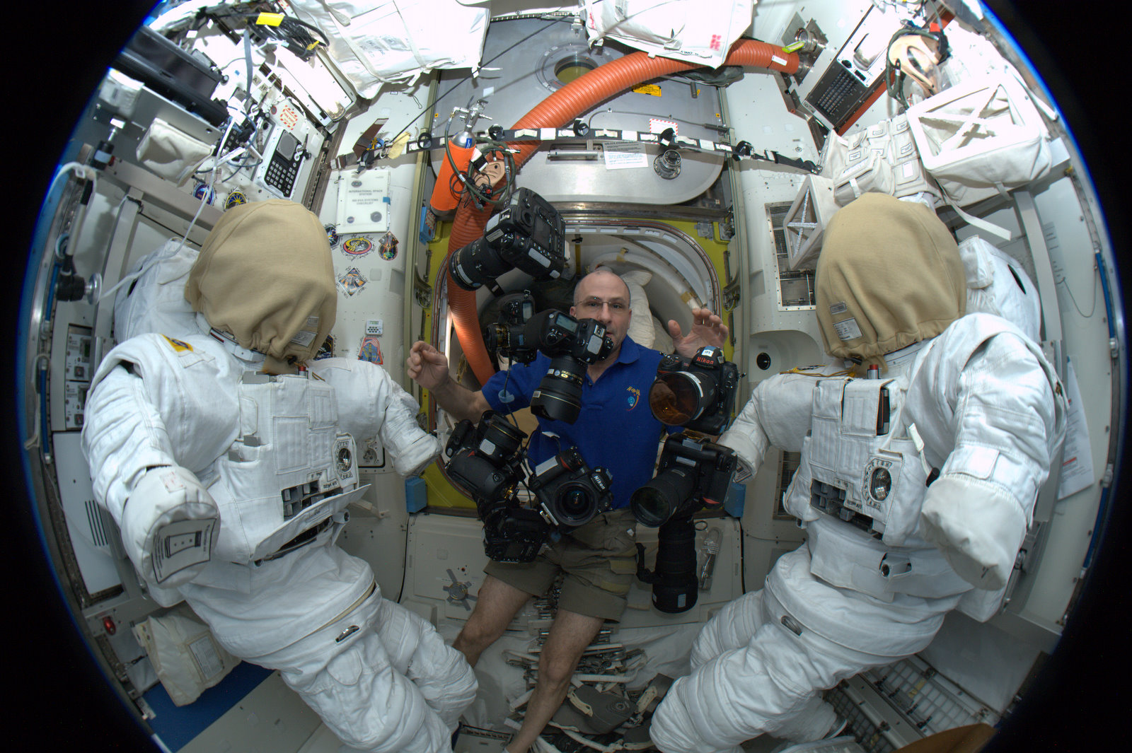NASA Space Photographer , juggling cameras in space Cameraplex