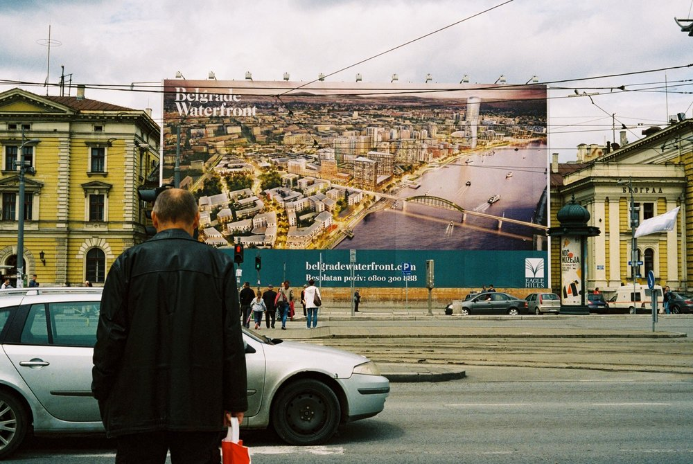 A Giant Advertisement on the Old Train Station with a Render of the Future Waterfront