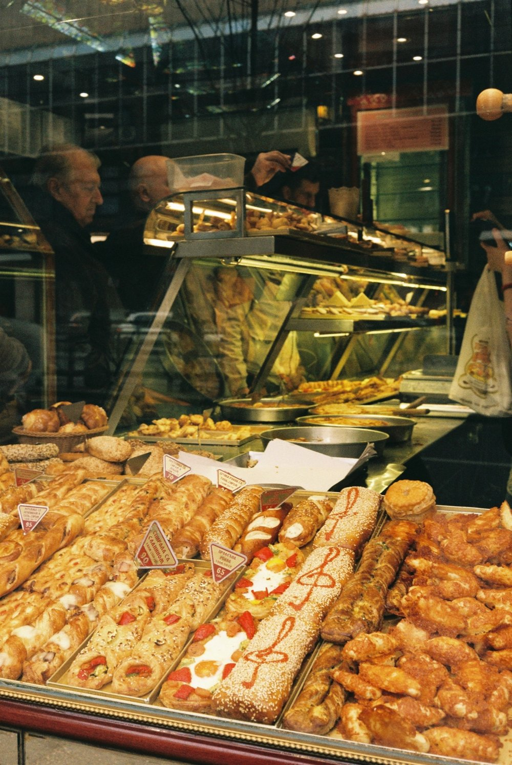 Bakery window showing goods from $0.65 to $0.95, Belgrade - Serbia