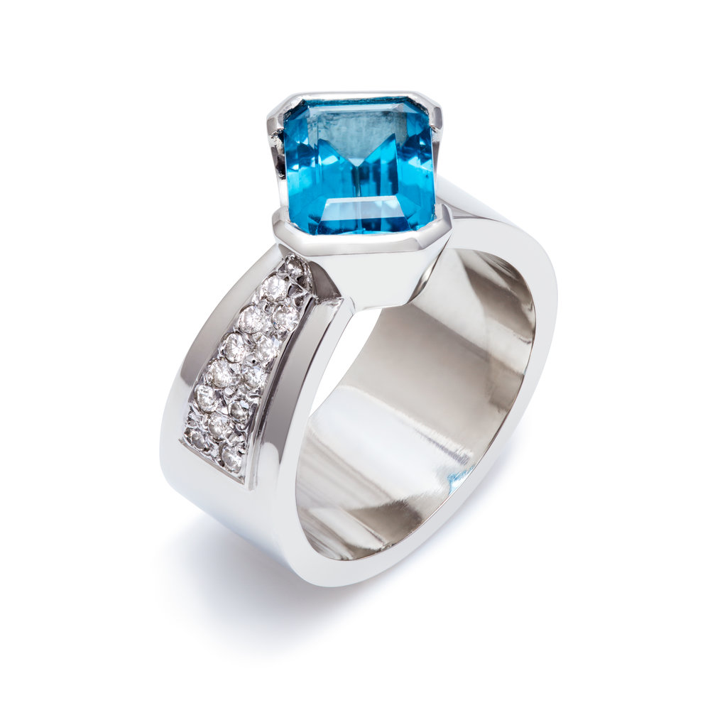 Bespoke platinum, blue topaz and diamond ring commission