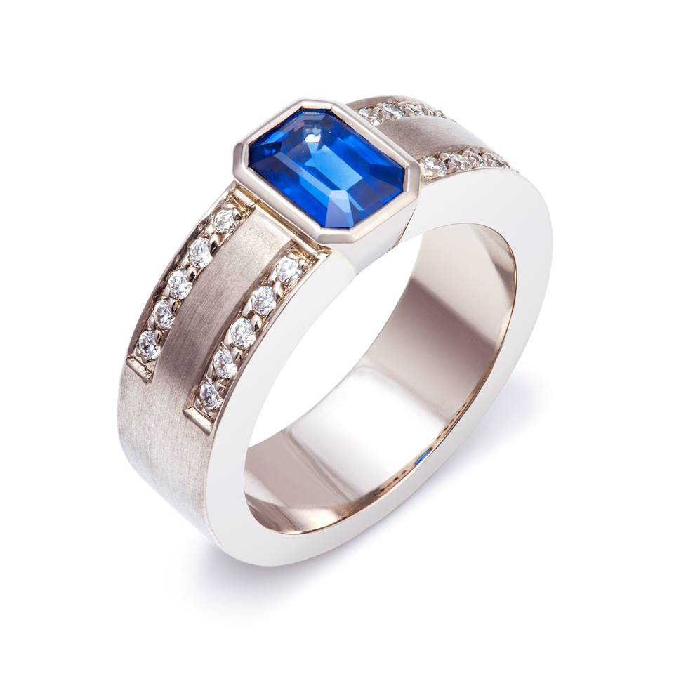 18ct white gold dress ring set with one sapphire and twent round brilliant cut diamonds - £5,130