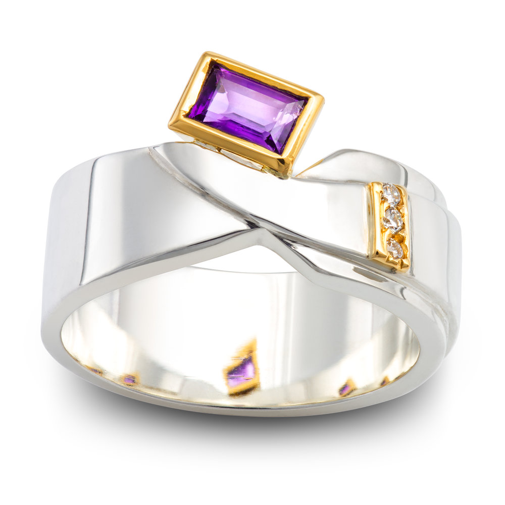 Silver and yellow gold dress ring set with one amethyst and three diamonds - £508