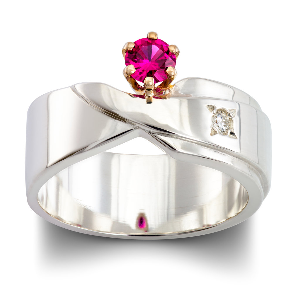 Silver dress ring set with one lab created red spinel in an 18ct white gold claw setting and one diamond - £381
