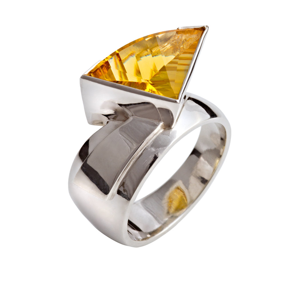 Silver dress ring set with one fancy cut beryl - £700